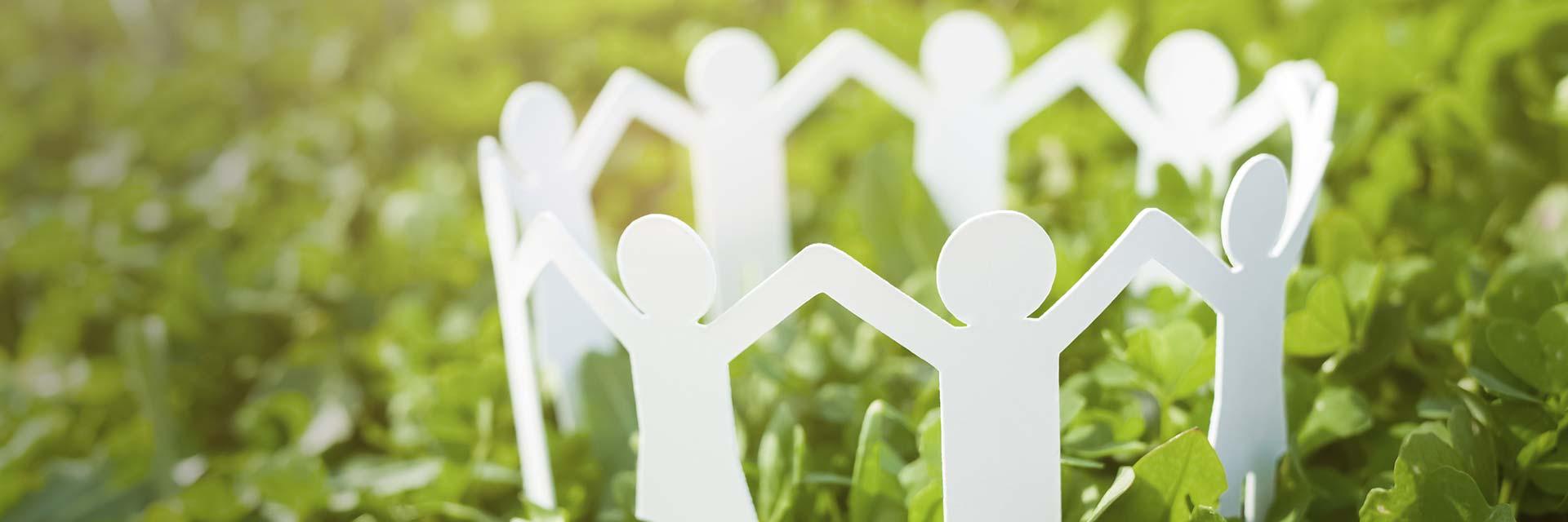 Ledarskap illustrerat av figurer som tillsammans bildar cirkel för att skapa trygghet i organisationen